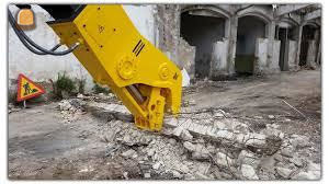 Gestolen: Crusher Atlas Copco en Pladdet betonschaar op werf Antwerpen Noordersingel