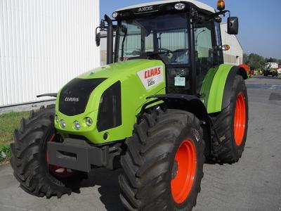 VERMIST: Claas AXOS 340 CX tractor en Dakota 414 bezander