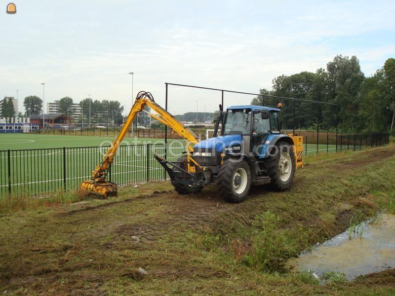Tractor + maaikorf NH + Herder