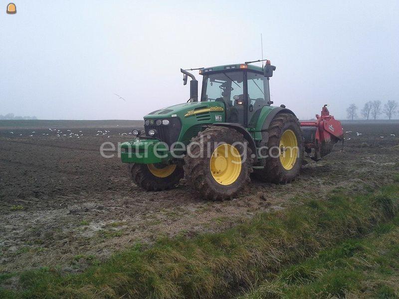 tractor met spitmachine