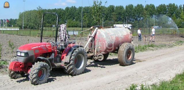 Tractor + waterwagen Mc.Corm met tank 3m3