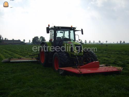 Tractor + schotelmaaier claas met vicon