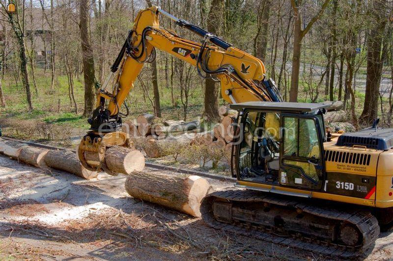 CAT 315 met bomengrijper