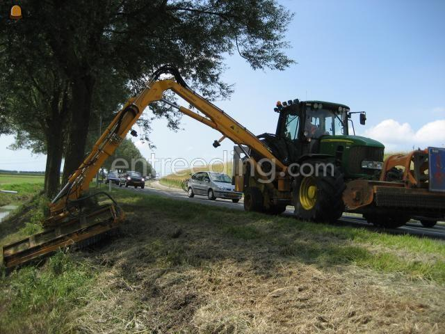 Tractor + armklepelmaaier John Deere 7530