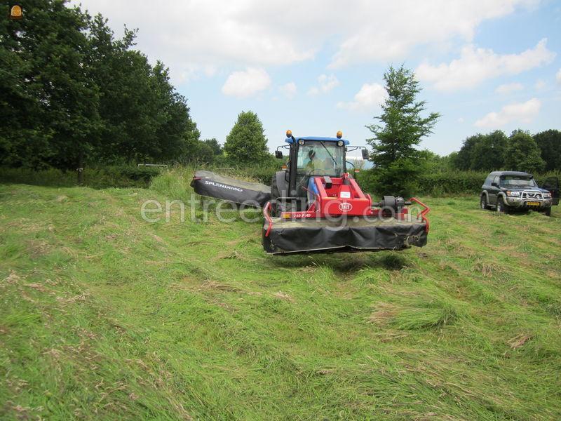 Tractor + schijvenmaaier New Holland T4050 met maaiers