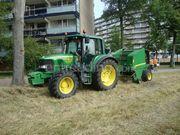 Tractor + oprolpers Trekker + John Deere pers
