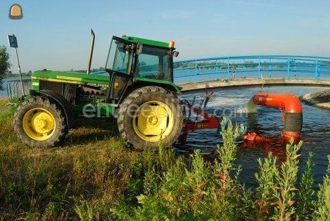 Tractor + pompen John Deere + grote pomp