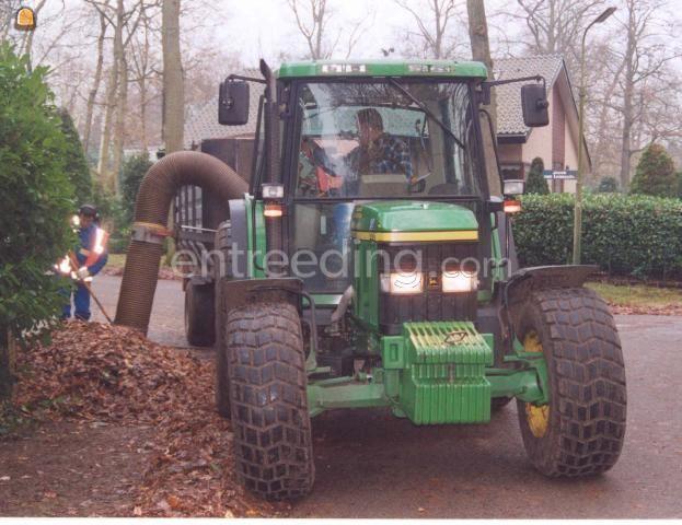 Tractor John Deere 6410 met bladzuiger