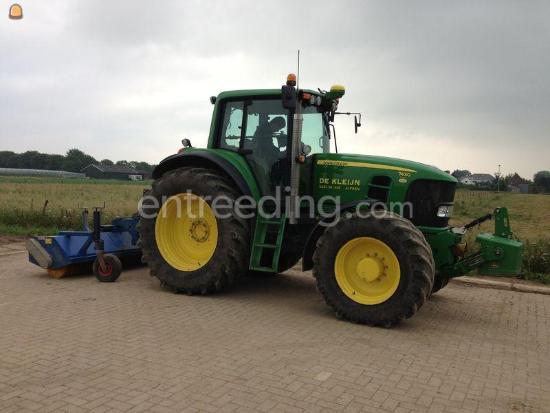 Tractor + veegmachine
