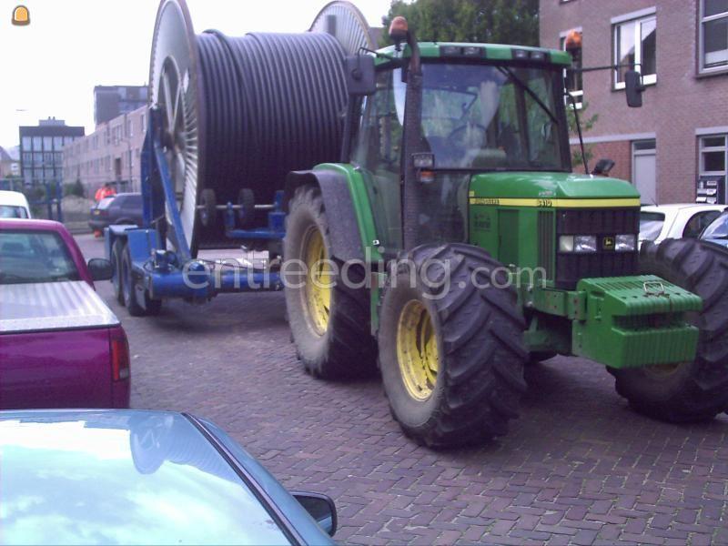 Tractor + haspelwagen John Deere + haspelwagen