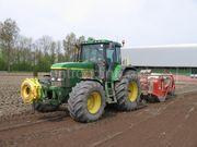 Tractor + grondfrees NH TVT195 met diepspitter