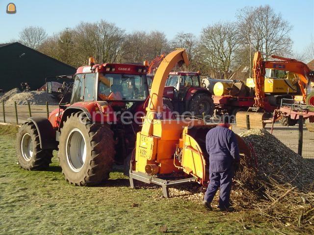 Tractor + houtversnipperaar Case + takkenversnipperaar