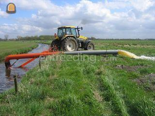 New Holland met WATER POM... Omgeving Breda