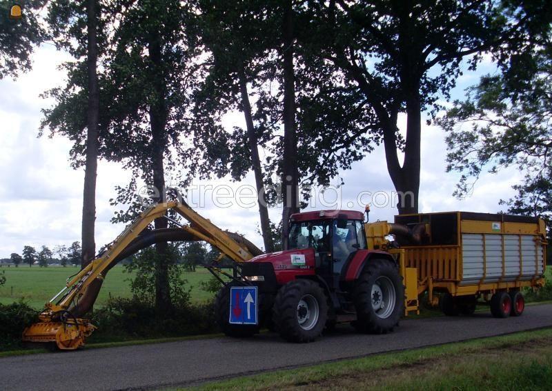 Tractor + maai/ zuigcombinatie Case + maai/zuig combinatie