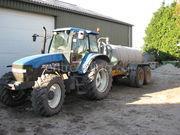 Tractor + waterwagen new holland + veenhuis