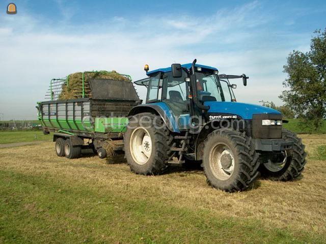 Tractor + opraapwagen trekker met raapwagen