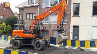 Doosan DX140W + Tiltrotat... Omgeving Ronse, Oudenaarde