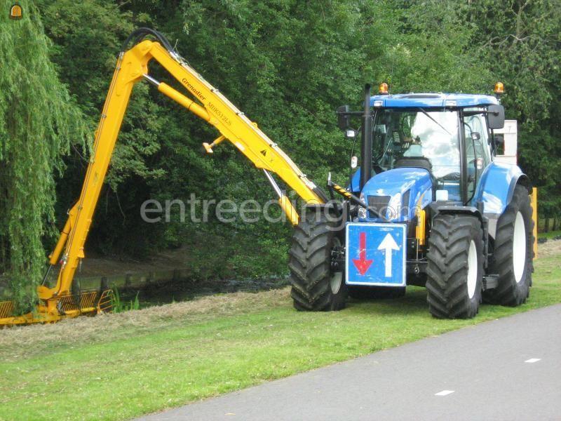 Tractor + slotenreiniger New Holland + herder
