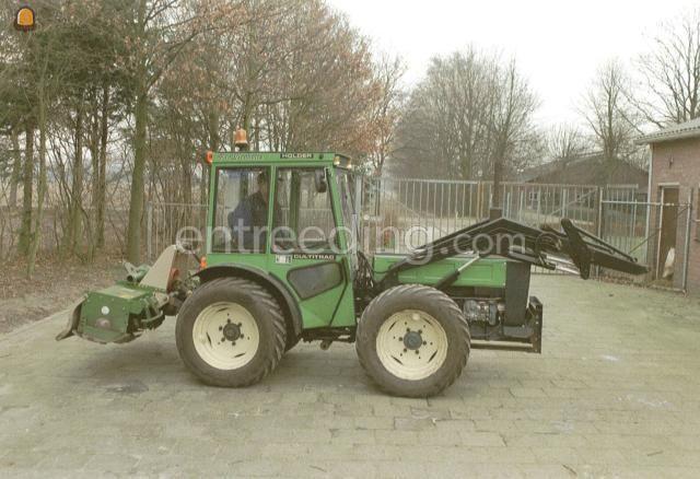 Tractor + grondfrees Holder kniktractor met grondfrees