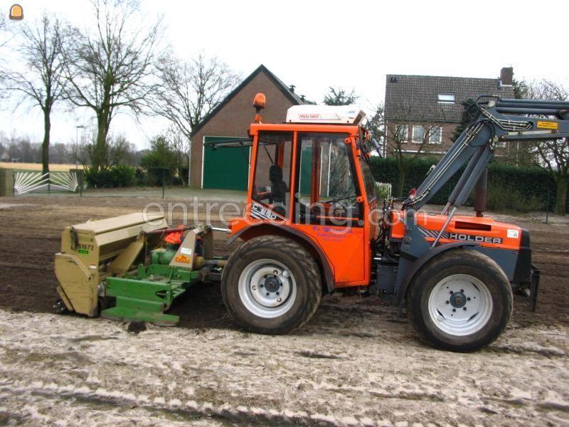 Tractor + rotorkopeg + zaaimachine Holder rotorkopeg en zaaimachine