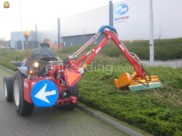 Tractor + armklepelmaaier NEW HOLLAND TCE 55