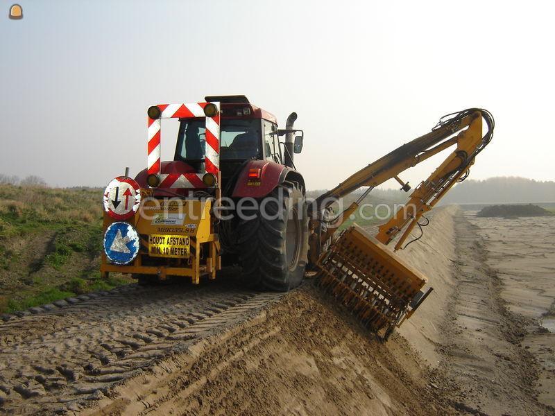 Tractor + armklepelmaaier Talud zaaimachine