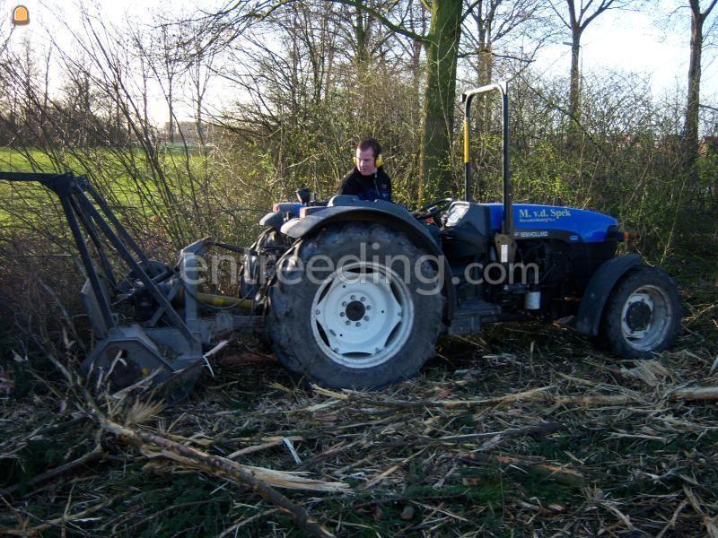 Tractor + bosfrees bosbouw klepelmaaier