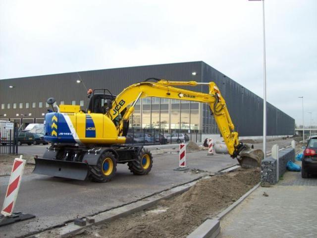 JCB JS145W mobiele graafmachine voor Oskam Loonbedrijf B.V. uit Moordrecht