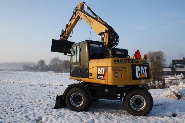 Caterpillar M 313 D mobiele graafmachine voor Van Schaik Grondverzet B.V. uit Harmelen
