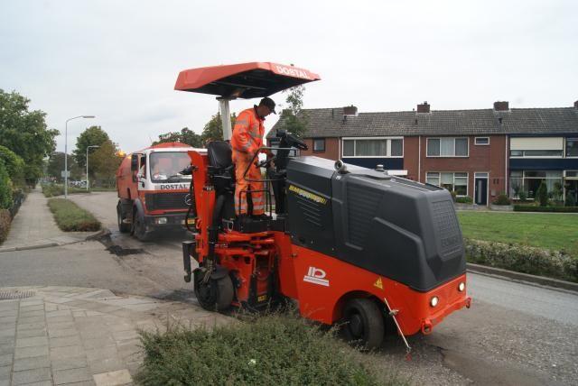Bomag BM 500 / 15 asfaltfrees voor Dostal uit Vorden
